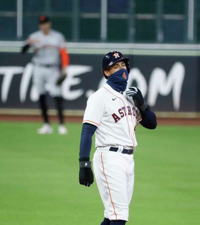 Houston Astros George Springer stands on second base as a pinch-runner for Michael Brantley during the tenth inning of an MLB baseball game at Minute Maid Park, Tuesday, August 11, 2020, in Houston.