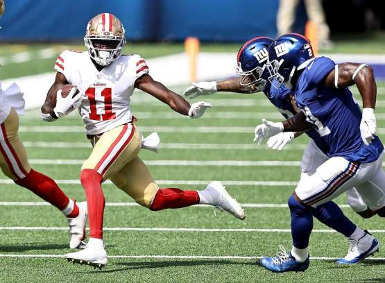49ers' rookie receiver Brandon Aiyuk caught five passes for 70 yards and added 31 yards rushing on three carries - 19 of which came on a third-quarter touchdown run.