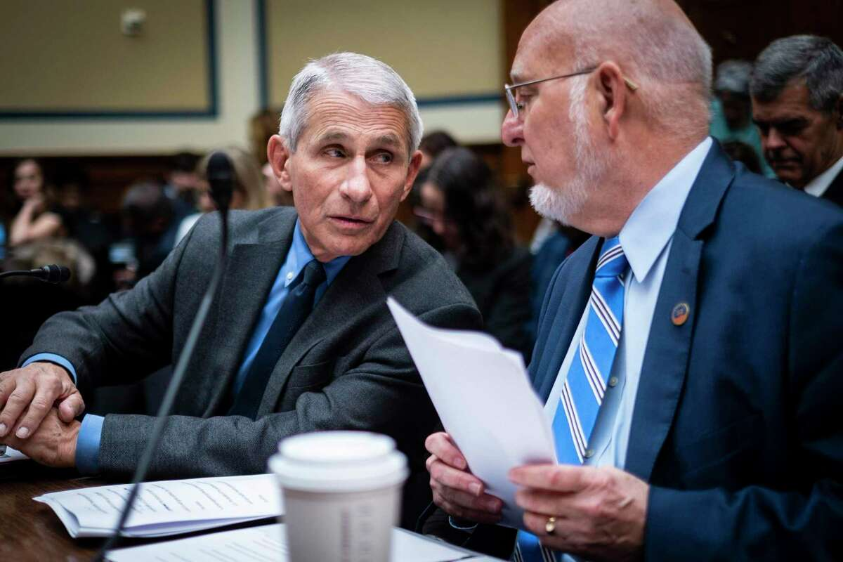 FILE -- Drs. Anthony Fauci, left, director of the National Institute of Allergy and Infectious Diseases, and Robert Redfield, director of the Centers for Disease Control and Prevention, during a House Committee hearing on Capitol Hill in Washington, March 11, 2020. By all accounts, Dr. Rochelle Walensky, director of the Centers for Disease Control and Prevention, is a fierce advocate and an empathetic scientist - but CDC advice must be better attuned to the real world, critics say. (Pete Marovich/The New York Times)