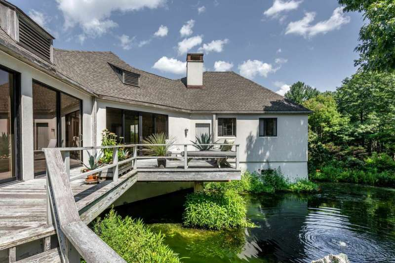 The deck on the home on 114 Seherr ThossDrive in Litchfield, Conn. has a brook in its backyard.