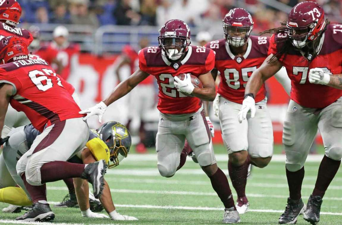 Aaron Green gathers blockers on a run up the middle for San Antonio as the Commanders play San Diego at the Alamodome in the opening game for the Alliance of American Football league in 2019. The league folded before it finished its first season.