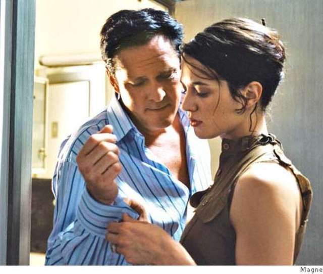 Asia Argento And Michael Madsen In Boarding Gate A Magnet Releasing Film Photo Courtesy