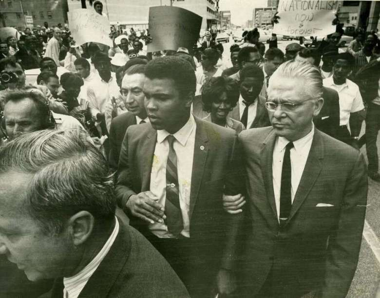 Muhammad Ali leaves Houston's Armed Forces Induction Center after refusing to be inducted into the Army on April 28, 1967. Photo: David Nance, Staff / Houston Chronicle