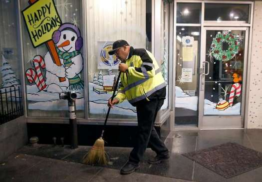 Director of Public Works Mohammed Nuru pitches in to help pick up trash in the Tenderloin in San Francisco, Calif. on Wednesday, Dec. 7, 2016.