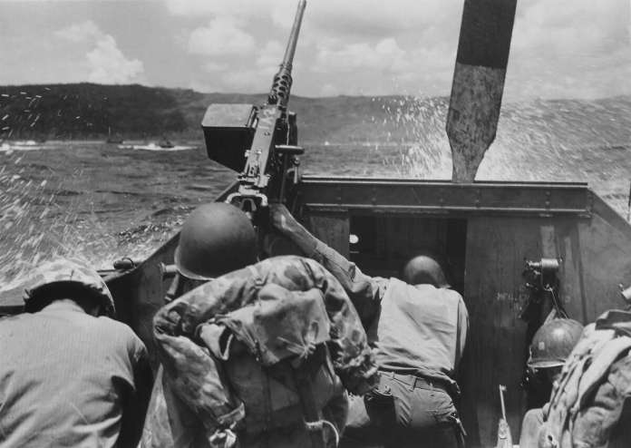 Guam- July 20: American Marines ducking below gunwales while approaching Ascan Point beaches in small landing craft during the fighting against Japanese forces for Asan Point.