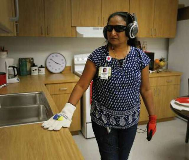 2of7faculty Member Jolly Punchamannil From The School Of Nursing At Ut Health San Antonio Roams In A Room Attempting To Do Tasks While Outfitted With