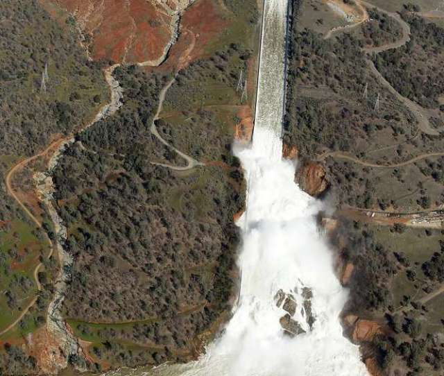Water Flows Out Of The Damaged Spillway At Oroville Dam In Oroville Calif