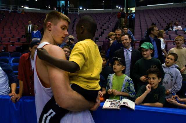 Syracuse University center Craig Forth picks 6-year-old Ethan Trudeau from a crowd of well-wishers at the Pepsi Arena in Albnany following practice on March 27,2003. Forth knows Ethan from the Parsons Child and Family Center, where he does work. Forth graduated from Columbia High School in East Greenbush.