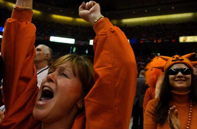 Andrea Hayes of East Greenbush, left, cheers on her Syracuse University team along with Julie Conti of Rochester, right, during Syracuse's 63-47 victory over Oklahoma in the NCAA East Regional at the Pepsi Arena in Albany on March 30, 2003.