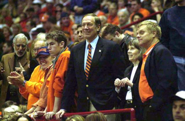 Gov. George Pataki, center, watche the Syracuse-Auburn game on March 28, 2003.