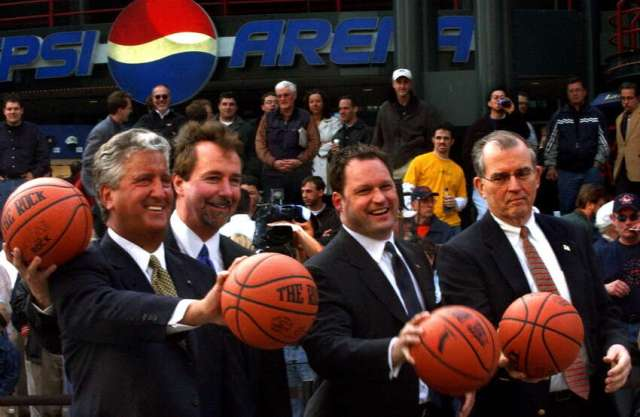 Albany officials pose for a photo during t he kick off of the NCAA Basketball Fan Fest on Friday, March 28, 2003, outside the Pepsi Arena in Albany. From left are Mayor Jerry Jennings, Pepsi Arena general manager Bob Belber, Key Bank president Tom Geisel, and Albany County executive Michael Breslin.