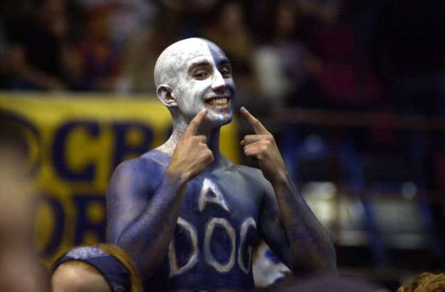 Butler college fan Eric Romer cheers his team during the NCAA basketball tournament in the Pepsi Arena in Albany March 28, 2003.