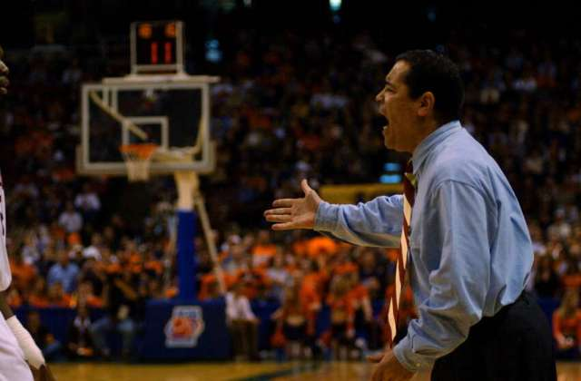 Oklahoma coach Kelvin Sampson exhorts his team during the first half of their 63-47 loss to Syracuse University in the NCAA East Regional at the Pepsi Arena in Albany pn March 30, 2003.