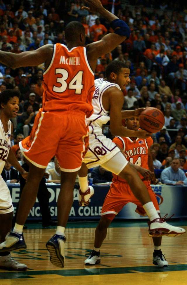 Oklahoma's De'Angelo Alexander tries to get by Syracuse University forward Jeremy McNeil during Syracuse's 63-47 victory over Oklahoma in the NCAA East Regional at the Pepsi Arena in Albany on March 30, 2003.