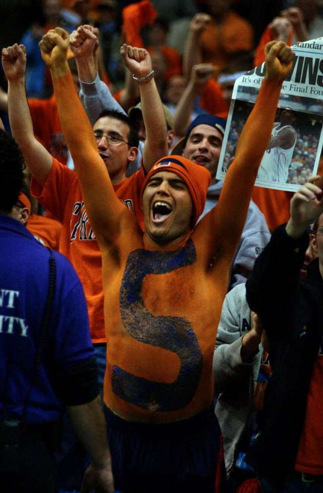 Syracuse University freshman Nick Friedell of Orlando, Fla., sports orange and blue body paint while celebrating after his team's 63-47 victory over Oklahoma in the NCAA East Regional at the Pepsi Arena in Albany.