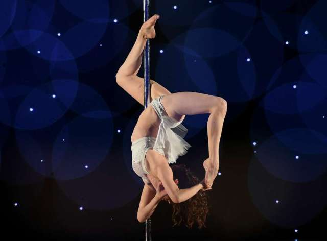 Photos of Pole Dancing Competition show just how hard it actually ...