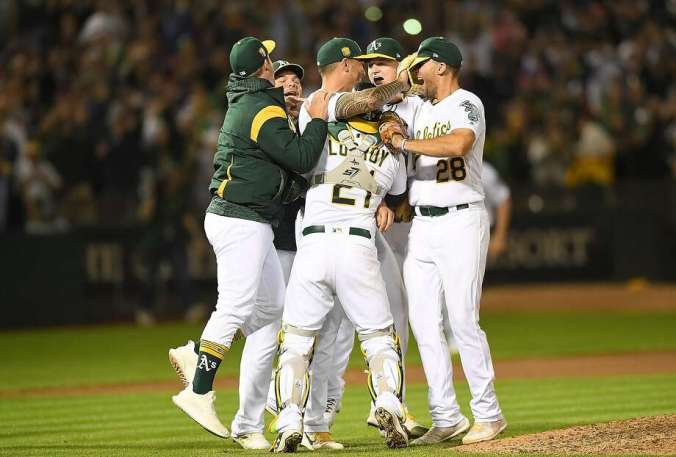 A's teammates swarm starting pitcher Sean Manaea after he pitched the seventh no-hitter in team history, blanking the red-hot Red Sox at the Coliseum on Saturday night. Photo: Thearon W. Henderson / Getty Images