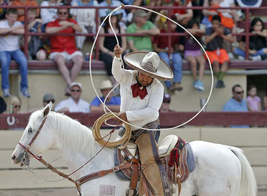 Carrier Nortenos de Houston Jesus Flores takes part in a team ropes event during the Day in Old Mexican and Carreada last year. Photo: Photo Team / © 2018 San Antonio Express-News