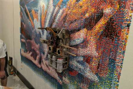 Bay Area company invents robot that paints giant murals on the sides     Albert the mural painting robot paints a test print of a digital image  designed after brainwave