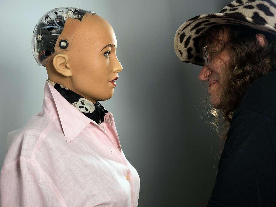 Ben Goertzel of Hanson Robotics, with his humanoid robot Sophia, wants AI networks to help each other. Photo: Pierfrancesco Celada / New York Times