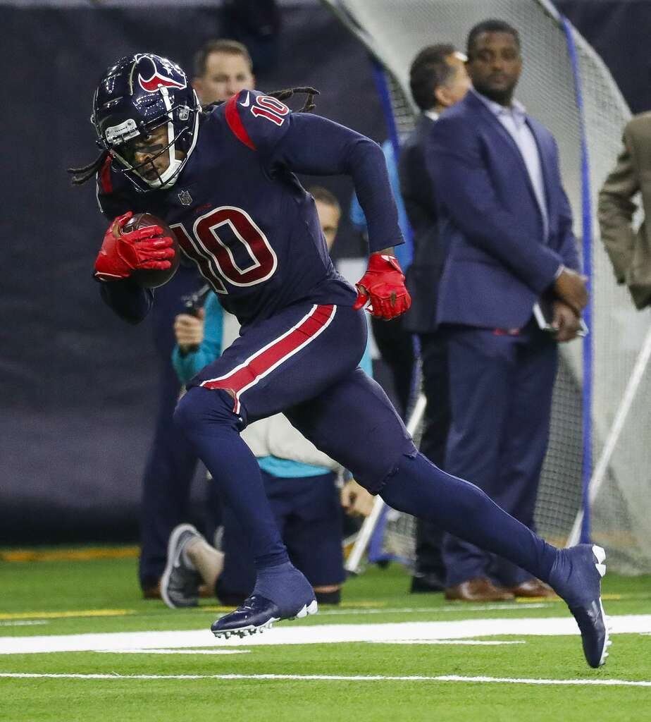 Houston Texans wide receiver DeAndre Hopkins (10) runs downfield with a 49 yard touchdown reception from quarterback Deshaun Watson (4) during the fourth quarter of an NFL game at NRG Stadium, Thursday, Oct. 25, 2018, in Houston. Photo: Karen Warren/Staff Photographer