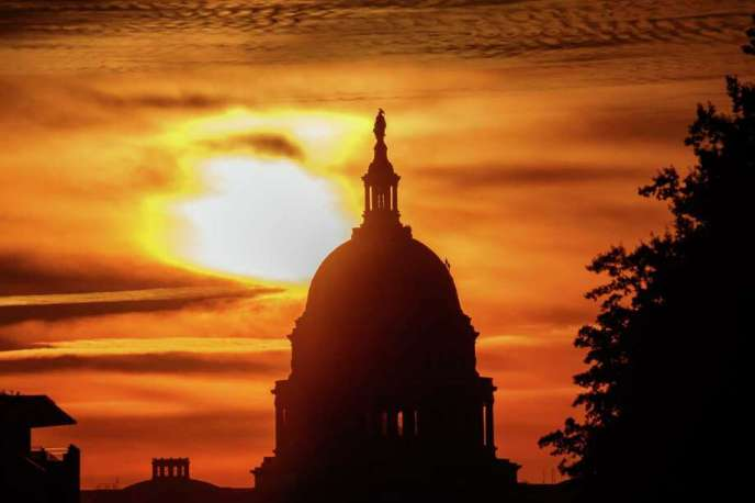 FILE- In this Oct. 26, 2018, file photo the rising sun silhouettes the U.S. Capitol dome at daybreak in Washington. The Treasury Department issues a report Tuesday, Nov. 13, on how much money Uncle Sam took in and paid out last month. (AP Photo/Alex Brandon, File) Photo: Alex Brandon / Copyright 2018 The Associated Press. All rights reserved.