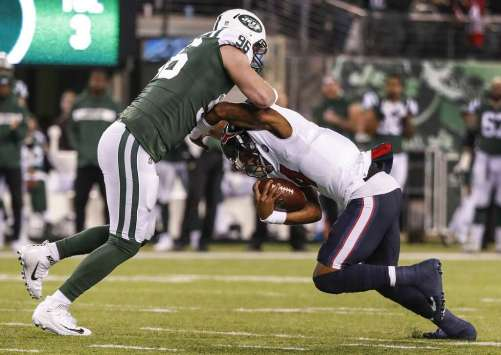 <p>New York Jets defensive end Henry Anderson (96) sacks Houston Texans quarterback Deshaun Watson (4) during the first quarter of an NFL football game at MetLife Stadium on Saturday, Dec. 15, 2018, in East</p>
