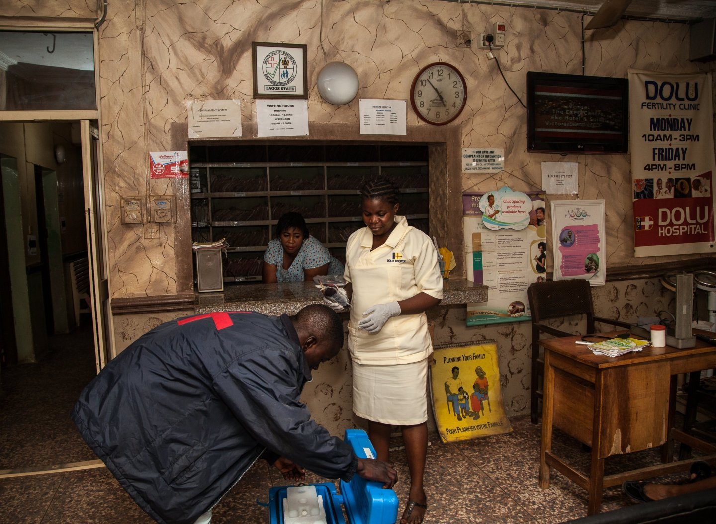 A LifeBank driver delivers blood to a hospital in Lagos, Nigeria. LifeBank is seeking to address the city's blood shortage by connecting blood banks and hospitals, as well as organizing blood donation drives. ADEOLA OLAGUNJU FOR NEWSWEEK