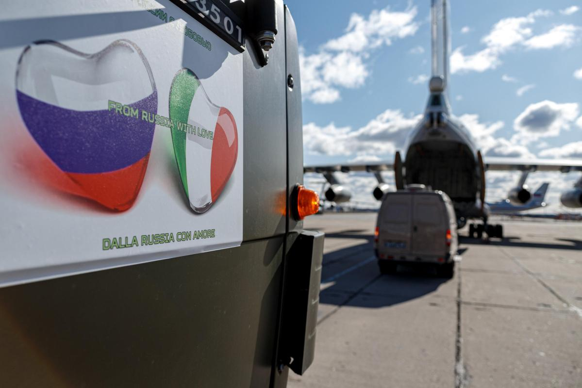 The Russian aid arrives in Italy, but some claim Russia has a hidden agenda.