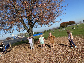 Second graders play in the leaves!