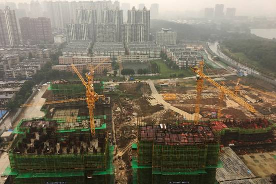 Chinese Cities Buy Off Housing Glut With Borrowed Money BN VO504 CGLUTj G 20171012163119