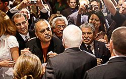 [McCain Crowd]