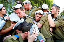 Israeli soldiers mourn the death of fellow soldier Alex Mashavisky at his funeral in Beersheba on Wednesday, the day after Mr. Mashavisky was killed during Israel's offensive in the Gaza Strip.