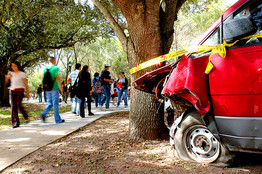 [A crashed vehicle displayed for Texas State Technical College students in November 2006 in a safety program sponsored by Mothers Against Drunk Driving.]