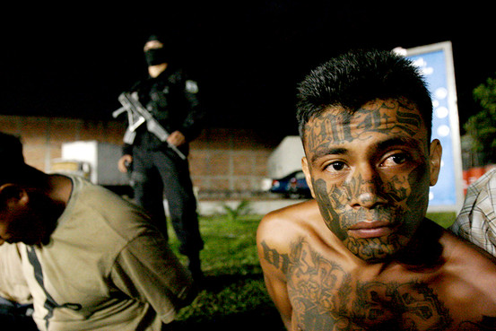 ManuelGomez, right, an allegedmemberofMara Salvatrucha, orMS-13 gang,was arrested inSanSalvador inFebruary 2008in a roundupof 23 alleged gangmemberswanted on homicide charges.