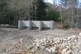 Concrete buttresses have been built for a bridge crossing the Big Sur River to a campground on the other side, but work to finish the bridge itself was still underway when the project ground to a halt a few weeks ago.