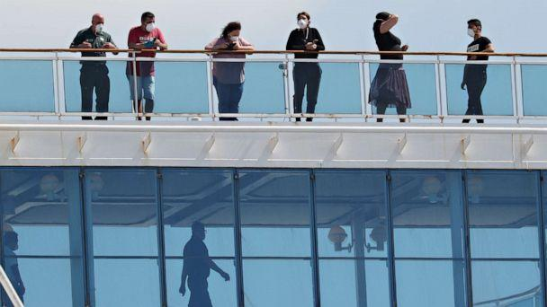 PHOTO: People are seen aboard the cruise ship Coral Princess after it docked in Port Miami on April 04, 2020 in Miami. (Joe Raedle / Getty Images)