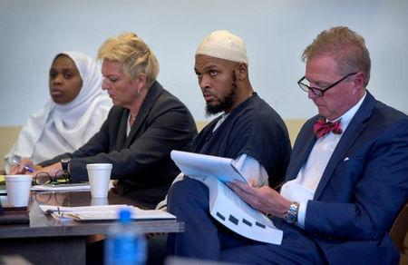 Defendant Jany Leveille (L to R) sits next to her defense lawyer Kelly Golightley, defendant Siraj Ibn Wahhaj and his defense lawyer Tom Clark at hearing in Taos County District Court in Taos County, New Mexico, U.S., August 29, 2018. Eddie Moore/Pool via REUTERS