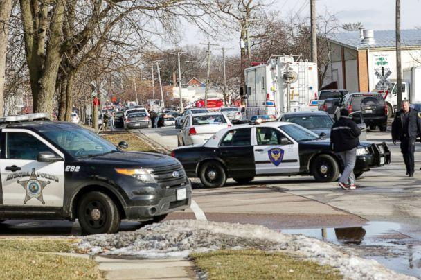 PHOTO: Law enforcement personnel gather near the scene of a shooting at an industrial park in Aurora, Ill., Feb. 15, 2019. (Bev Horne/Daily Herald via AP)
