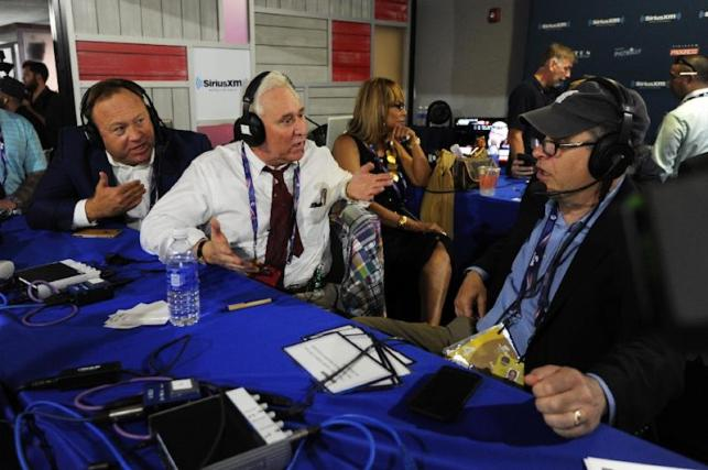 """Alex Jones (L), of Infowars, and Roger Stone, a former Donald Trump advisor, debate with Jonathan Alter during an episode of Alter Family Politics during the 2016 election campaign -- Facebook has removed several of Jones' online pages from its platform, accusing him of """"glorifying violence."""""""