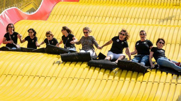 PHOTO: A group of women ride a giant slide together on the first day of the Minnesota Fair in Falcon Heights, Minnesota, on August 22, 2019. (Star Tribune via Getty Images, FILE)