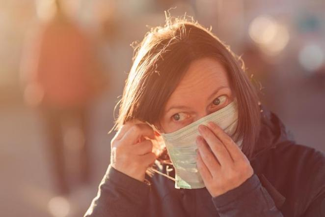 Do not touch the front of your mask with your hands after using one, because the front of the mask could be contaminated. (Photo: stevanovicigor via Getty Images)