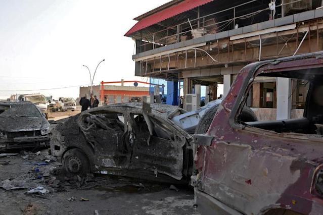 Wrecked vehicles line the street outside the Abu Layla restaurant in Iraq's Mosul on November 9, 2018, after three people were killed in the first car bombing to hit the second city since its recapture from the Islamic State group in July last year