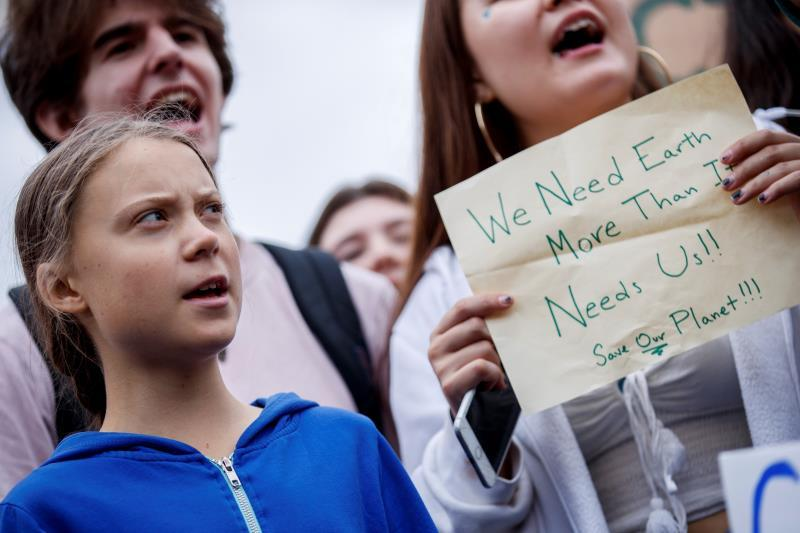 Greta Thunberg (L), the 16 year old climate change activist from Sweden, participates in a School Strike for Climate reform on the Ellipse near the White House in Washington, DC, USA, 13 September 2019. EFE/EPA/SHAWN THEW