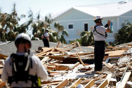 A search and rescue team works in homes destroyed by Hurricane Michael in Mexico Beach, Florida, U.S., October 16, 2018.   REUTERS/Terray Sylvester