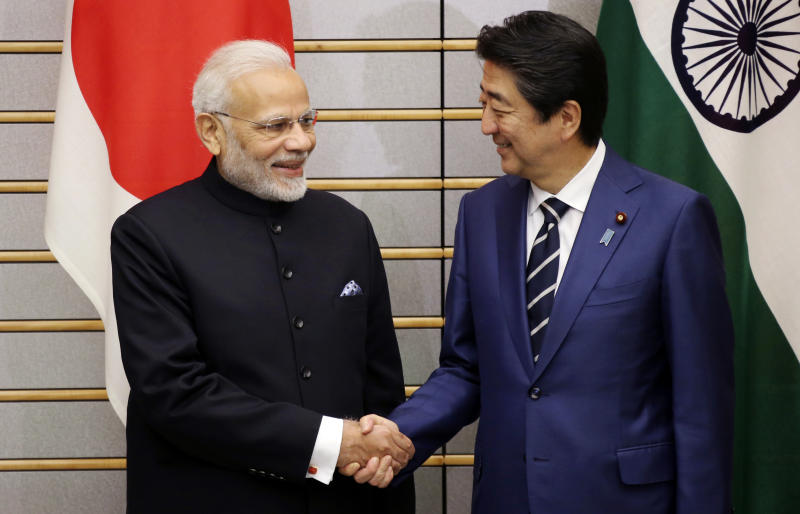 Indian Prime Minister Narendra Modi, left, shakes hands with Japan's Prime Minister Shinzo Abe prior to their meeting at Abe's official residence in Tokyo Monday, Oct. 29, 2018. (AP Photo/Koji Sasahara, Pool)