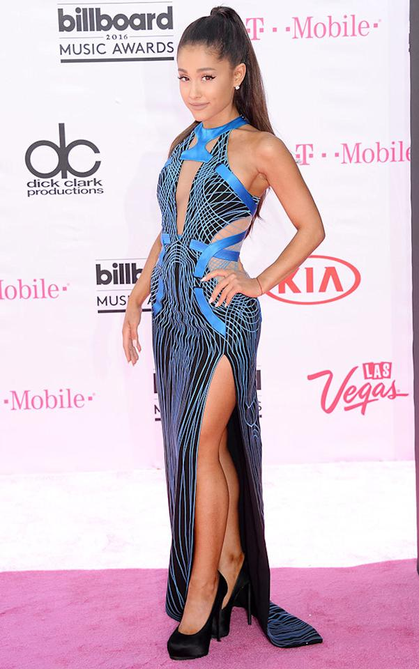 """<p>Could you walk in that dress and those shoes? The """"Dangerous Woman"""" singer almost took a tumble on the pink carpet but recovered nicely with a toss of her signature ponytail. Grande's dress is on trend with cutouts and is giving <a href=""""http://www.schlockmania.com/wp-content/uploads/2010/12/Tron-03.jpg"""">major vintage <i>Tron</i> vibes</a>.<i>(Photo: Broadimage/REX/Shutterstock)</i></p>"""
