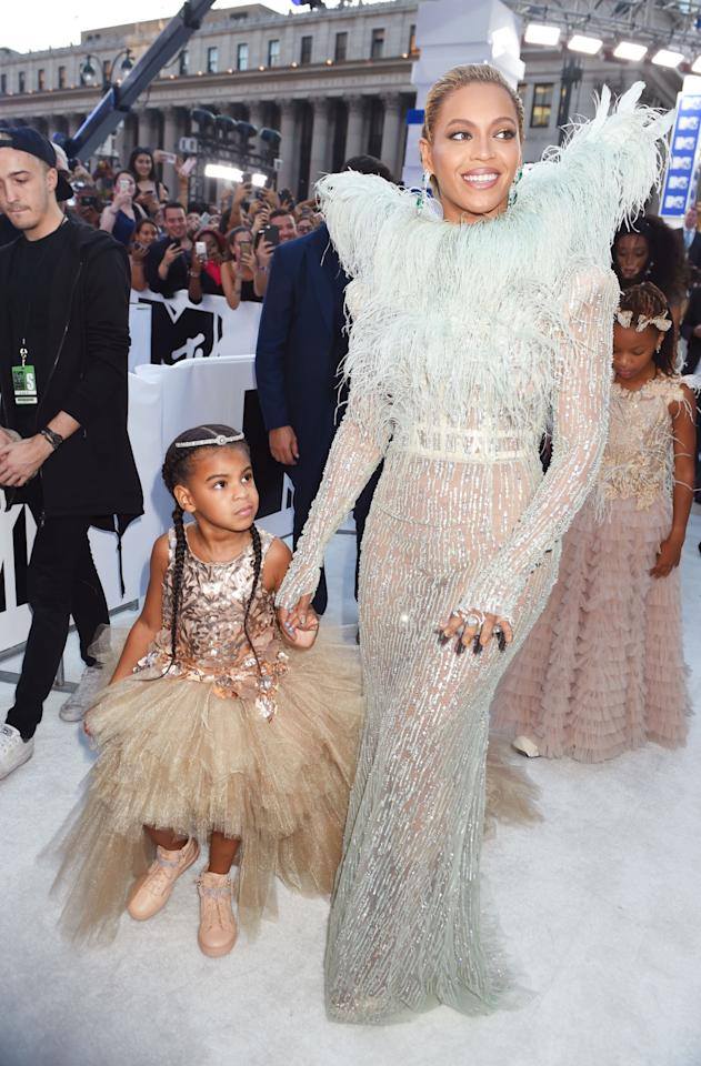 <p>Beyonce, who confirmed at the last minute that she's performing, chose a look from Francesco Scognamiglio's Fall 2016 couture collection covered in sequins and featuring feather wings. She brought along daughter Blue Ivy, wearing a shiny top and massive tutu skirt with pink sneakers and hair extensions, as her date and both looked like fairies from a far off fashionable land. <i>(Photo: Getty Images)</i></p>