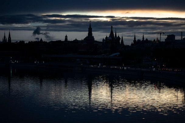 PHOTO: The Kremlin, left, and St. Basil Cathedral, center right, are reflected in the Moskva River during sunset in Moscow, Russia, on May 20, 2020. (Pavel Golovkin/AP)
