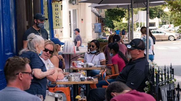 PHOTO: Customers have lunch near the restaurant, as on June 15, 2020 the city of Hoboken, New Jersey, reopens the city after being blocked from the coronavirus (Jeenah Moon / Getty Images)